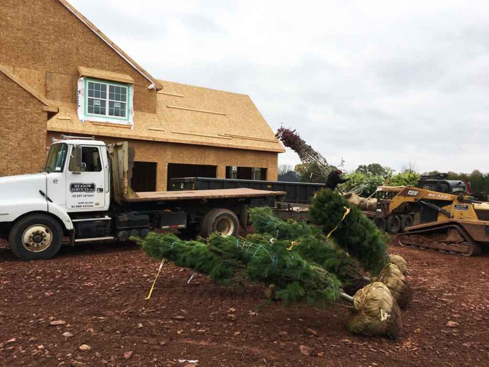 Meadow Services landscaping vehicle with GPS tracking on job site