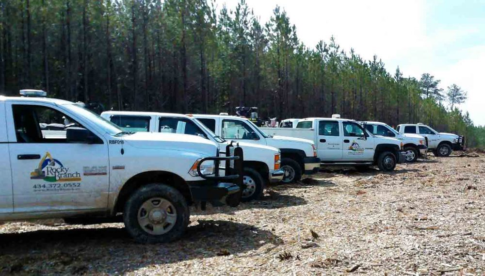 Line of Rocky Branch Contractor construction services vehicles fitted with Quartix Vehicle Tracking