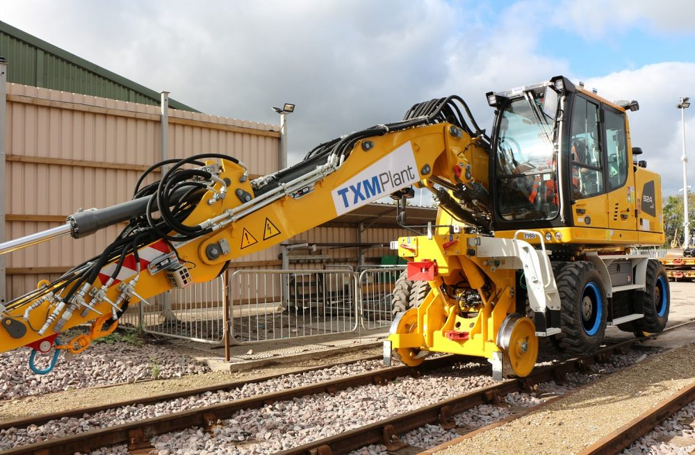 TXM Plant Hire vehicle working on railway