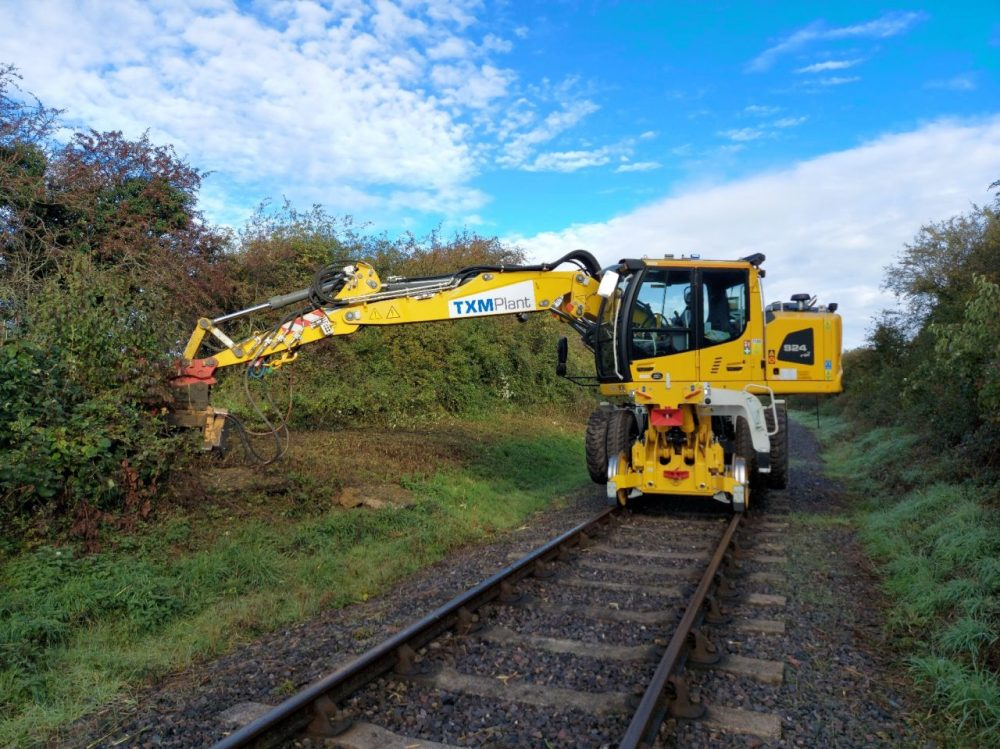 TXM Plant Hire vehicle on the tracks