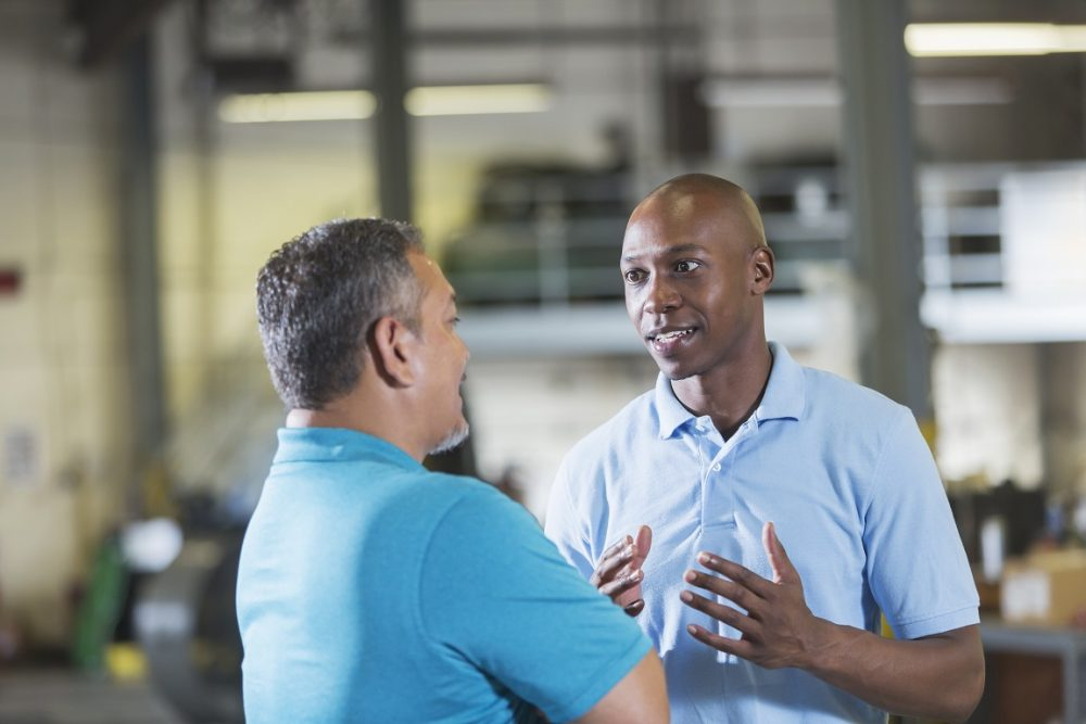 fleet manager and driver reviewing driving performance